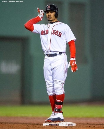 BOSTON, MA - APRIL 26: Mookie Betts #50 of the Boston Red Sox reacts after hitting a double during the ninth inning of a game against the New York Yankees on April 26, 2017 at Fenway Park in Boston, Massachusetts. (Photo by Billie Weiss/Boston Red Sox/Getty Images) *** Local Caption *** Mookie Betts