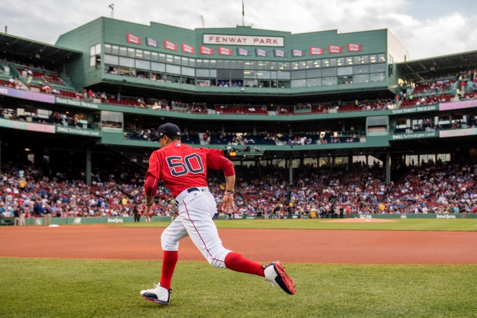 BOSTON, MA - APRIL 28: Mookie Betts #50 of the Boston Red Sox warms up before a game against the Chicago Cubs on April 28, 2017 at Fenway Park in Boston, Massachusetts. (Photo by Billie Weiss/Boston Red Sox/Getty Images) *** Local Caption ***Mookie Betts