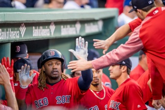BOSTON, MA - APRIL 28: Hanley Ramirez #13 of the Boston Red Sox high fives teammates after scoring during the first inning of a game against the Chicago Cubs on April 27, 2017 at Fenway Park in Boston, Massachusetts. (Photo by Billie Weiss/Boston Red Sox/Getty Images) *** Local Caption *** Hanley Ramirez