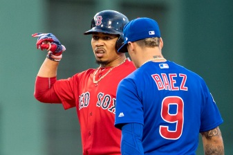 BOSTON, MA - APRIL 28: Mookie Betts #50 of the Boston Red Sox reacts alongside Javier Baez #9 of the Chicago Cubs after hitting a double during the first inning of a game on April 27, 2017 at Fenway Park in Boston, Massachusetts. (Photo by Billie Weiss/Boston Red Sox/Getty Images) *** Local Caption *** Mookie Betts; Javier Baez