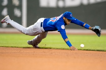 BOSTON, MA - APRIL 28: Addison Russell #27 of the Chicago Cubs dives for a ground ball during the fourth inning of a game against the Boston Red Sox on April 27, 2017 at Fenway Park in Boston, Massachusetts. (Photo by Billie Weiss/Boston Red Sox/Getty Images) *** Local Caption *** Addison Russell