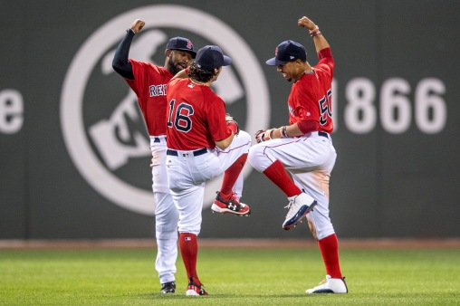 BOSTON, MA - APRIL 28: Jackie Bradley Jr. #19, Andrew Benintendi #16, and Mookie Betts #50 of the Boston Red Sox celebrate a victory against the Chicago Cubs on April 27, 2017 at Fenway Park in Boston, Massachusetts. (Photo by Billie Weiss/Boston Red Sox/Getty Images) *** Local Caption *** Jackie Bradley Jr.; Andrew Benintendi; Mookie Betts