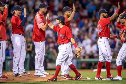 BOSTON, MA - APRIL 28: Andrew Benintendi #16 of the Boston Red Sox high fives teammates after a game against the Chicago Cubs on April 27, 2017 at Fenway Park in Boston, Massachusetts. (Photo by Billie Weiss/Boston Red Sox/Getty Images) *** Local Caption *** Andrew Benintendi