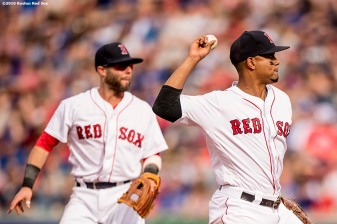 BOSTON, MA - APRIL 29: Xander Bogaerts #2 and Dustin Pedroia #15 of the Boston Red Sox turn a double play during the third inning of a game against the Chicago Cubs on April 29, 2017 at Fenway Park in Boston, Massachusetts. (Photo by Billie Weiss/Boston Red Sox/Getty Images) *** Local Caption *** Xander Bogaerts; Dustin Pedroia