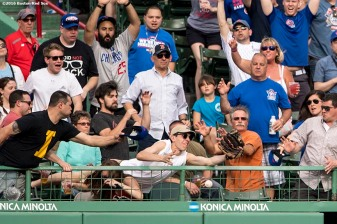 BOSTON, MA - APRIL 29: A fan reaches for a home run ball hit by Anthony Rizzo #44 of the Chicago Cubs during the fourth inning of a game against the Boston Red Sox on April 29, 2017 at Fenway Park in Boston, Massachusetts. (Photo by Billie Weiss/Boston Red Sox/Getty Images) *** Local Caption ***
