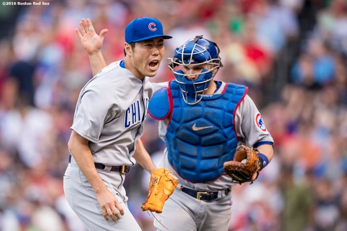BOSTON, MA - APRIL 29: Koji Uehara #19 of the Chicago Cubs reacts with Miguel Montero #47 during the seventh inning of a game against the Boston Red Sox on April 29, 2017 at Fenway Park in Boston, Massachusetts. (Photo by Billie Weiss/Boston Red Sox/Getty Images) *** Local Caption *** Koji Uehara; Miguel Montero
