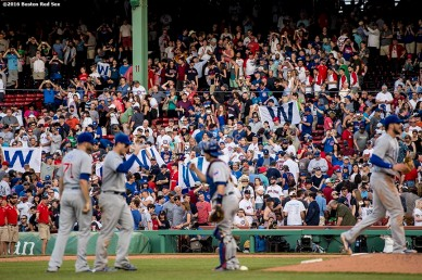 BOSTON, MA - APRIL 29: Fans fly the W flags as members of the Chicago Cubs celebrate a victory against the Boston Red Sox on April 29, 2017 at Fenway Park in Boston, Massachusetts. (Photo by Billie Weiss/Boston Red Sox/Getty Images) *** Local Caption ***