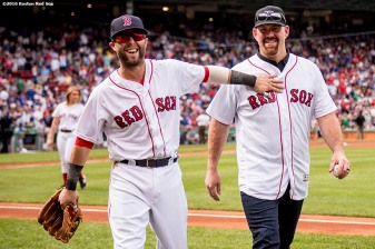 BOSTON, MA - APRIL 29: Former Boston Red Sox third baseman Kevin Youkilis reacts with Dustin Pedroia #15 of the Boston Red Sox after throwing out the ceremonial first pitch before a game against the Chicago Cubs on April 29, 2017 at Fenway Park in Boston, Massachusetts. (Photo by Billie Weiss/Boston Red Sox/Getty Images) *** Local Caption *** Kevin Youkilis; Dustin Pedroia