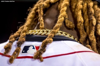 BOSTON, MA - APRIL 30: The necklace and hair of Hanley Ramirez #13 of the Boston Red Sox is shown before a game against the Chicago Cubs on April 30, 2017 at Fenway Park in Boston, Massachusetts. (Photo by Billie Weiss/Boston Red Sox/Getty Images) *** Local Caption *** Hanley Ramirez