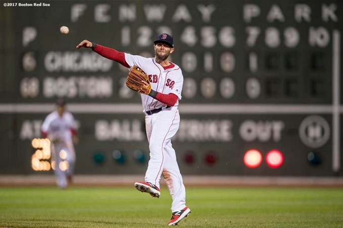 BOSTON, MA - APRIL 30: Dustin Pedroia #15 of the Boston Red Sox throws to first base during the eighth inning of a game against the Chicago Cubs on April 30, 2017 at Fenway Park in Boston, Massachusetts. (Photo by Billie Weiss/Boston Red Sox/Getty Images) *** Local Caption *** Dustin Pedroia