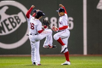 BOSTON, MA - APRIL 30: Andrew Benintendi #16, Jackie Bradley Jr. #19, and Mookie Betts #50 of the Boston Red Sox celebrate a victory against the Chicago Cubs on April 30, 2017 at Fenway Park in Boston, Massachusetts. (Photo by Billie Weiss/Boston Red Sox/Getty Images) *** Local Caption *** Andrew Benintendi; Mookie Betts; Jackie Bradley Jr.