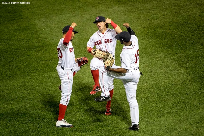 BOSTON, MA - MAY 2: Mookie Betts #50, Jackie Bradley Jr. #19, and Andrew Benintendi #16 of the Boston Red Sox celebrate a victory against the Baltimore Orioles on May 2, 2017 at Fenway Park in Boston, Massachusetts. (Photo by Billie Weiss/Boston Red Sox/Getty Images) *** Local Caption *** Mookie Betts; Jackie Bradley Jr.; Andrew Benintendi