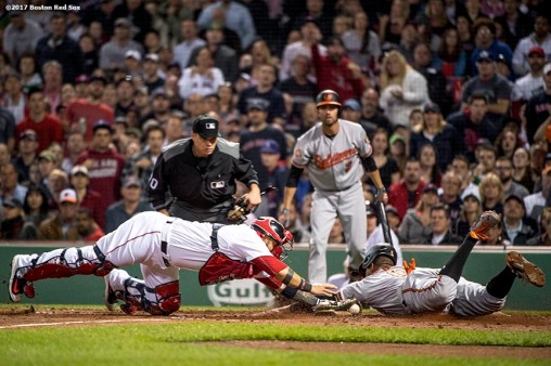BOSTON, MA - MAY 2: Jonathan Schoop #6 of the Baltimore Orioles slides as he evades the tag of Sandy Leon #3 of the Boston Red Sox to score during the fifth inning of a game on May 2, 2017 at Fenway Park in Boston, Massachusetts. (Photo by Billie Weiss/Boston Red Sox/Getty Images) *** Local Caption *** Jonathan Schoop; Sandy Leon