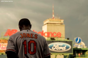 BOSTON, MA - MAY 2: Adam Jones #10 of the Baltimore Orioles looks on during the National Anthem before a game against the Boston Red Sox on May 2, 2017 at Fenway Park in Boston, Massachusetts. (Photo by Billie Weiss/Boston Red Sox/Getty Images) *** Local Caption *** Adam Jones