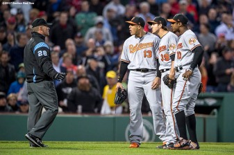 BOSTON, MA - MAY 3: Kevin Gausman #39 of the Baltimore Orioles argues alongside Manny Machado #13 and Adam Jones #10 with umpire Jim Wolf after being ejected from the game for hitting Xander Bogaerts #2 of the Boston Red Sox with a pitch during the second inning of a game on May 3, 2017 at Fenway Park in Boston, Massachusetts. (Photo by Billie Weiss/Boston Red Sox/Getty Images) *** Local Caption *** Kevin Gausman; Manny Machado; Adam Jones; Jim Wolf