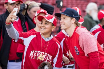 BOSTON, MA - MAY 4: Brock Holt #12 of the Boston Red Sox poses for a selfie with a little leaguer before a game against the Baltimore Orioles on May 4, 2017 at Fenway Park in Boston, Massachusetts. (Photo by Billie Weiss/Boston Red Sox/Getty Images) *** Local Caption *** Brock Holt