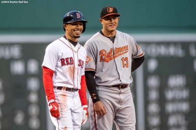 BOSTON, MA - MAY 4: Mookie Betts #50 of the Boston Red Sox reacts with Manny Machado #13 of the Baltimore Orioles during the first inning of a game on May 4, 2017 at Fenway Park in Boston, Massachusetts. (Photo by Billie Weiss/Boston Red Sox/Getty Images) *** Local Caption *** Mookie Betts; Manny Machado