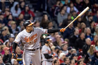 BOSTON, MA - MAY 4: Manny Machado #13 of the Baltimore Orioles hits a three run home run during the fourth inning of a game against the Boston Red Sox on May 4, 2017 at Fenway Park in Boston, Massachusetts. (Photo by Billie Weiss/Boston Red Sox/Getty Images) *** Local Caption *** Manny Machado