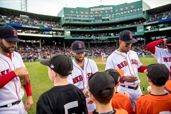 BOSTON, MA - MAY 4: Kids take the field with Dustin Pedroia #15 and Xander Bogaerts #2 of the Boston Red Sox before a game against the Baltimore Orioles on May 4, 2017 at Fenway Park in Boston, Massachusetts. (Photo by Billie Weiss/Boston Red Sox/Getty Images) *** Local Caption *** Dustin Pedroia; Xander Bogaerts