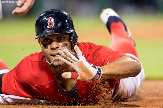 BOSTON, MA - MAY 12: Xander Bogaerts #2 of the Boston Red Sox reacts as he slides into first base during a pick off attempt during the fourth inning of a game against the Tampa Bay Rays on May 12, 2017 at Fenway Park in Boston, Massachusetts. (Photo by Billie Weiss/Boston Red Sox/Getty Images) *** Local Caption *** Xander Bogaerts