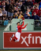 BOSTON, MA - MAY 12: Mookie Betts #50 of the Boston Red Sox attempts to catch a line drive during the sixth inning of a game against the Tampa Bay Rays on May 12, 2017 at Fenway Park in Boston, Massachusetts. (Photo by Billie Weiss/Boston Red Sox/Getty Images) *** Local Caption *** Mookie Betts