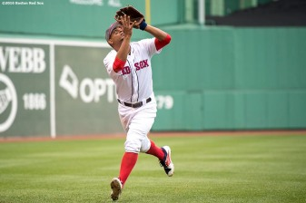 BOSTON, MA - MAY 13: Xander Bogaerts #2 of the Boston Red Sox catches a fly ball during the seventh inning of a game against the Tampa Bay Rays on May 13, 2017 at Fenway Park in Boston, Massachusetts. (Photo by Billie Weiss/Boston Red Sox/Getty Images) *** Local Caption *** Xander Bogaerts