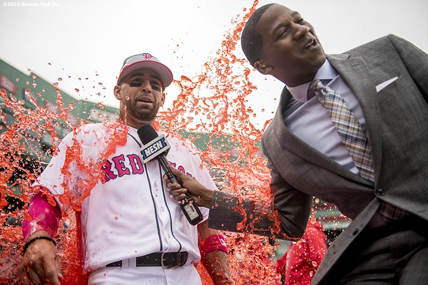 BOSTON, MA - MAY 13: Deven Marrero #17 of the Boston Red Sox reacts after getting doused with a Powerade shower while being interviewed by NESN anchor Jahmai Webster after a game against the Tampa Bay Rays on May 13, 2017 at Fenway Park in Boston, Massachusetts. (Photo by Billie Weiss/Boston Red Sox/Getty Images) *** Local Caption *** Deven Marrero; Jahmai Webster