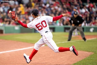 BOSTON, MA - MAY 23: Mookie Betts #50 of the Boston Red Sox catches a fly ball during the first inning of a game against the Texas Rangers on May 23, 2017 at Fenway Park in Boston, Massachusetts. (Photo by Billie Weiss/Boston Red Sox/Getty Images) *** Local Caption *** Mookie Betts