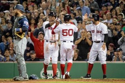 BOSTON, MA - MAY 23: Mookie Betts #50 of the Boston Red Sox high fives Xander Bogaerts #2 and Deven Marrero #17 after scoring during the sixth inning of a game against the Texas Rangers on May 23, 2017 at Fenway Park in Boston, Massachusetts. (Photo by Billie Weiss/Boston Red Sox/Getty Images) *** Local Caption *** Mookie Betts; Xander Bogaerts; Deven Marrero
