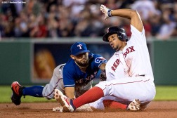 BOSTON, MA - MAY 23: Xander Bogaerts #2 of the Boston Red Sox slides into second base after hitting an RBI double during the sixth inning of a game against the Texas Rangers on May 23, 2017 at Fenway Park in Boston, Massachusetts. (Photo by Billie Weiss/Boston Red Sox/Getty Images) *** Local Caption *** Xander Bogaerts