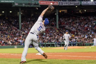 BOSTON, MA - MAY 24: Mike Napoli #5 of the Texas Rangers drops a fly ball during the fourth inning of a game against the Boston Red Sox on May 24, 2017 at Fenway Park in Boston, Massachusetts. (Photo by Billie Weiss/Boston Red Sox/Getty Images) *** Local Caption *** Mike Napoli