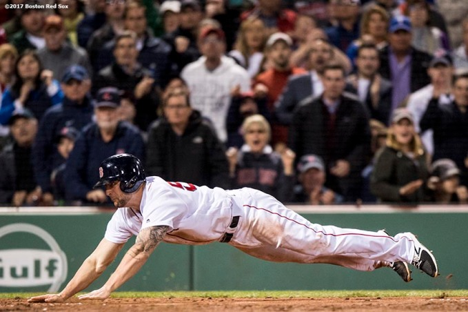 BOSTON, MA - MAY 24: Sam Travis #59 of the Boston Red Sox dives as he scores during the seventh inning of a game against the Texas Rangers on May 24, 2017 at Fenway Park in Boston, Massachusetts. (Photo by Billie Weiss/Boston Red Sox/Getty Images) *** Local Caption *** Sam Travis