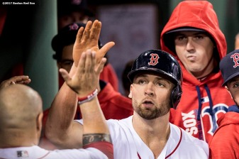 BOSTON, MA - MAY 24: Sam Travis #59 of the Boston Red Sox high fives teammates after scoring during the seventh inning of a game against the Texas Rangers on May 24, 2017 at Fenway Park in Boston, Massachusetts. (Photo by Billie Weiss/Boston Red Sox/Getty Images) *** Local Caption *** Sam Travis