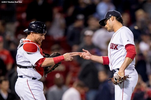 BOSTON, MA - MAY 24: Christian Vazquez #7 and Joe Kelly #56 of the Boston Red Sox celebrate a victory against the Texas Rangers on May 24, 2017 at Fenway Park in Boston, Massachusetts. (Photo by Billie Weiss/Boston Red Sox/Getty Images) *** Local Caption *** Christian Vazquez; Joe Kelly