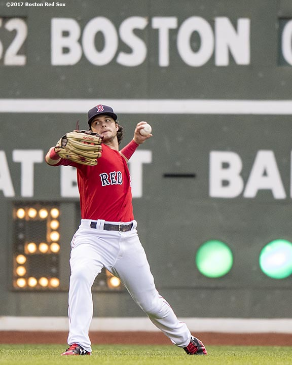 BOSTON, MA - MAY 26: Andrew Benintendi #16 of the Boston Red Sox throws the ball during the second inning of a game against the Seattle Mariners on May 26, 2017 at Fenway Park in Boston, Massachusetts. (Photo by Billie Weiss/Boston Red Sox/Getty Images) *** Local Caption *** Andrew Benintendi