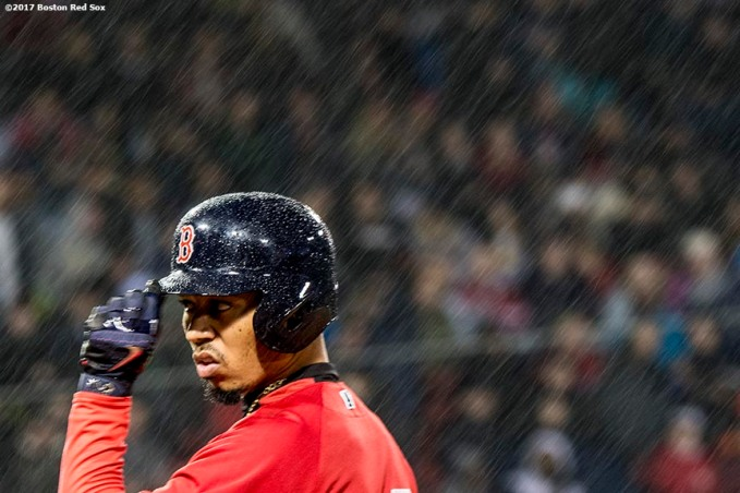 BOSTON, MA - MAY 26: Mookie Betts #50 of the Boston Red Sox reacts after reaching first base on a walk as rain falls during the sixth inning of a game against the Seattle Mariners on May 26, 2017 at Fenway Park in Boston, Massachusetts. (Photo by Billie Weiss/Boston Red Sox/Getty Images) *** Local Caption *** Mookie Betts
