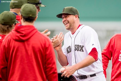 BOSTON, MA - MAY 27: Brian Johnson #61 of the Boston Red Sox high fives teammates after pitching a complete game against the Seattle Mariners on May 27, 2017 at Fenway Park in Boston, Massachusetts. (Photo by Billie Weiss/Boston Red Sox/Getty Images) *** Local Caption *** Brian Johnson