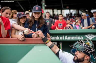 BOSTON, MA - MAY 28: Sandy Leon #3 of the Boston Red Sox signs autographs for fans before a game against the Seattle Mariners on May 28, 2017 at Fenway Park in Boston, Massachusetts. (Photo by Billie Weiss/Boston Red Sox/Getty Images) *** Local Caption *** Sandy Leon