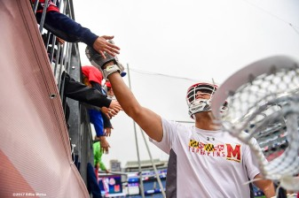 FOXBORO, MA - MAY 29: A member of the Maryland Terrapins high fives fans before the Division I Men's Lacrosse Championship against the Ohio State Buckeyes at Gillette Stadium on May 29, 2017 in Foxboro, Massachusetts. (Photo by Billie Weiss/Getty Images) *** Local Caption ***