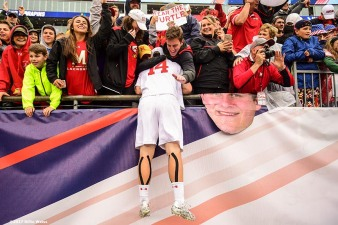 FOXBORO, MA - MAY 29: Tim Muller #14 of the Maryland Terrapins jumps into the stands after winning the Division I Men's Lacrosse Championship against the Ohio State Buckeyes at Gillette Stadium on May 29, 2017 in Foxboro, Massachusetts. (Photo by Billie Weiss/Getty Images) *** Local Caption *** Tim Muller