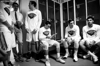 November 30, 2016, Newton, MA: Sam Bohmiller studies game notes with teammates in the locker room before a game against Bates University at Webster Sports Arena at Babson College in Newton, Massachusetts Wednesday, November 30, 2016. (Photo by Billie Weiss/Babson College Magazine)