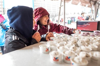 June 6, 2017, Boston, MA: Kids take cups of ice cream during the 2017 Jimmy Fund Scooper Bowl at City Hall Plaza in Boston, Massachusetts Tuesday, June 6, 2017. (Photo by Billie Weiss/Boston Red Sox)