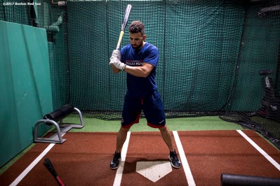 BOSTON, MA - JUNE 9: Deven Marrero #17 of the Boston Red Sox warms up in the batting cage before a game against the Detroit Tigers on June 9, 2017 at Fenway Park in Boston, Massachusetts. (Photo by Billie Weiss/Boston Red Sox/Getty Images) *** Local Caption *** Deven Marrero