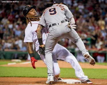 BOSTON, MA - JUNE 9: Hanley Ramirez #19 of the Boston Red Sox is tagged out by Nicholas Castellanos #9 of the Detroit Tigers during the fourth inning of a game on June 9, 2017 at Fenway Park in Boston, Massachusetts. (Photo by Billie Weiss/Boston Red Sox/Getty Images) *** Local Caption *** Hanley Ramirez; Nicholas Castellanos