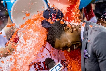 BOSTON, MA - JUNE 9: Jackie Bradley Jr. #19 of the Boston Red Sox is doused with Powerade alongside NESN anchor Jahmai Webster after a victory against the Detroit Tigers on June 9, 2017 at Fenway Park in Boston, Massachusetts. (Photo by Billie Weiss/Boston Red Sox/Getty Images) *** Local Caption *** Jackie Bradley Jr.; Jahmai Webster