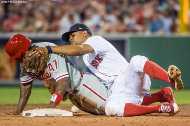 BOSTON, MA - JUNE 12: Xander Bogaerts #2 of the Boston Red Sox mishandles the ball as Howie Kendrick #47 of the Philadelphia Phillies steals second base during the fifth inning of a game on June 12, 2017 at Fenway Park in Boston, Massachusetts. (Photo by Billie Weiss/Boston Red Sox/Getty Images) *** Local Caption *** Xander Bogaerts; Howie Kendrick