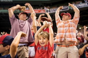 BOSTON, MA - JUNE 12: A young fan participates in the wave during a game between the Boston Red Sox and the Philadelphia Phillies on June 12, 2017 at Fenway Park in Boston, Massachusetts. (Photo by Billie Weiss/Boston Red Sox/Getty Images) *** Local Caption ***