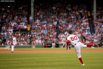 BOSTON, MA - JUNE 13: Mookie Betts #50 of the Boston Red Sox throws the ball to the infield during the first inning of a game against the Philadelphia Phillies on June 13, 2017 at Fenway Park in Boston, Massachusetts. (Photo by Billie Weiss/Boston Red Sox/Getty Images) *** Local Caption *** Mookie Betts