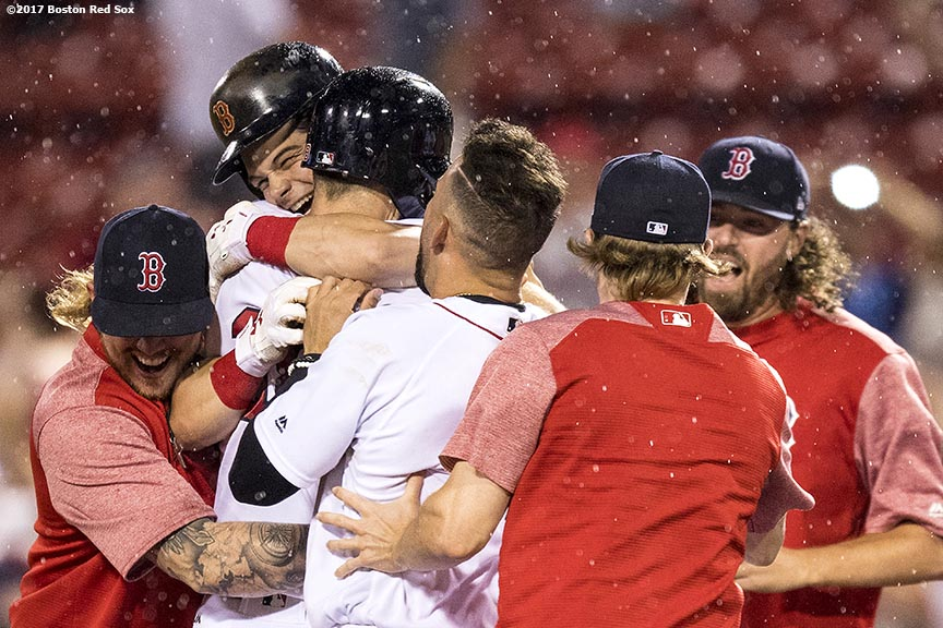 BOSTON, MA - JUNE 13: Andrew Benintendi #16 of the Boston Red Sox is mobbed by teammates after hitting a walk-off double to end the game against the Philadelphia Phillies on June 13, 2017 at Fenway Park in Boston, Massachusetts. (Photo by Billie Weiss/Boston Red Sox/Getty Images) *** Local Caption *** Andrew Benintendi