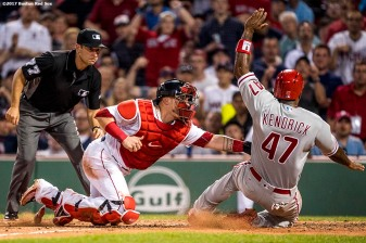 BOSTON, MA - JUNE 13: Christian Vazquez #7 of the Boston Red Sox tags out Howie Kendrick #47 of the Philadelphia Phillies during the eighth inning of a game on June 13, 2017 at Fenway Park in Boston, Massachusetts. (Photo by Billie Weiss/Boston Red Sox/Getty Images) *** Local Caption *** Christian Vazquez; Howie Kendrick